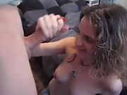 Skilled amateur chick knows how to suck and wank a huge dick