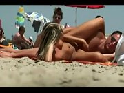 Spectacular blonde babe gets caught frolicking with her guy's impaler at the nudist beach