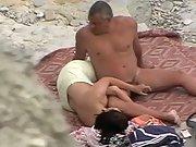 Housewife hj on a public nudist beach