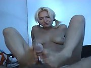 Pigtailed blonde providing a footjob and hand job